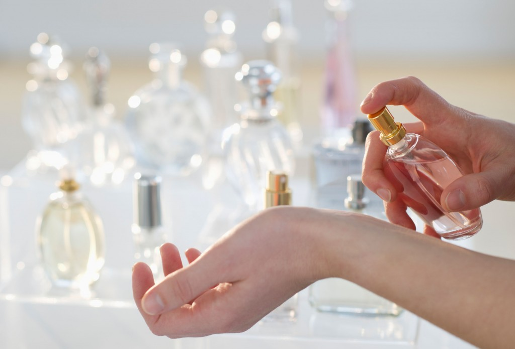 USA, New Jersey, Jersey City, Young woman testing perfume. Image shot 2011. Exact date unknown.